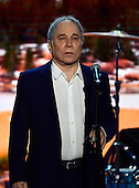 Singer and songwriter Paul Simon performs &quot;Bridge over Troubled Water&quot; at the 2016 Democratic National Convention at the Wells Fargo Center in Philadelphia, Pennsylvania on Monday, July 25, 2016.<br /> Credit: Ron Sachs / CNP<br /> (RESTRICTION: NO New York or New Jersey Newspapers or newspapers within a 75 mile radius of New York City)