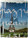 The Eiffel Tower viewed through the Wall for Peace, in Paris, France.