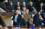 Walter Smith takes his seat in the stand after being sent packing by ref Steve Conroy and is involved in discussions with a Kilmarnock official
