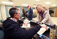 NWA Democrat-Gazette/FLIP PUTTHOFF <br />Poll worker Gina White gets Caryn Foresee (right) signed in to vote on Tuesday Dec. 4 2018 in the Bentonville mayoral election.