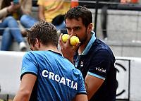 BOGOTA - COLOMBIA – 16 – 09 -2019: Nikola Metick (Izq.) y Marin Cilic (Der.) de Croacia y, durante partido de dobles de la Copa Davis entre los equipos de Colombia y Croacia, partidos por el ascenso al Grupo Mundial de Copa Davis por BNP Paribas, en la Plaza de Toros La Santamaria en la ciudad de Bogota. / Nikola Metick (L) and Marin Cilic (R) from Croatia, during a Davis Cup doubles tennis match between the teams of Colombia and Croatia, match promoted to the World Group Davis Cup by BNP Paribas, at the La Santamaria Ring Bull in Bogota city. / Photo: VizzorImage / Luis Ramirez / Staff.
