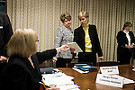 March 17, 2009. Raleigh, NC.. Images from one day in the life of Deborah K. Ross, Representative for North Carolina House District 38.. 10:02 AM. Ross reviews notes before chairing a committee meeting to discuss the proposed bill to ban smoking in public places, of which she is the primary sponsor.