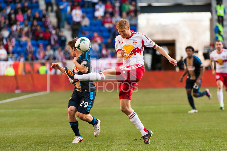 Markus Holgersson (5) of the New York Red Bulls clears a ball in front of Antoine Hoppenot (29) of the Philadelphia Union. The New York Red Bulls defeated the Philadelphia Union 2-1 during a Major League Soccer (MLS) match at Red Bull Arena in Harrison, NJ, on March 30, 2013.