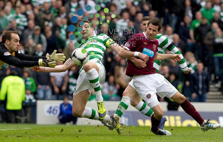Charlie Mulgrew of Celtic kicks the ball as keeper Jamie MacDonald saves as  Ryan McGowan of Hearts looks on during the Scottish Cup 2012 semi final -Celtic v Hearts at Hampden Park, Glasgow Scotland..Picture: Universal News And Sport (Europe).15 April 2012. www.unpixs.com.