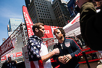 Former men's national team player Cobi Jones is interviewed by Jimmy Conrad during the centennial celebration of U. S. Soccer at Times Square in New York, NY, on April 04, 2013.