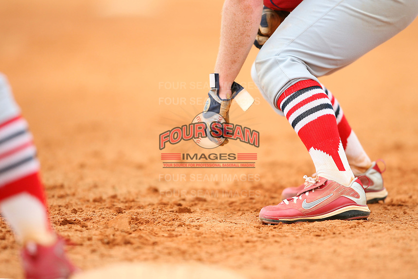 April 14, 2009:  A member of the St. Louis Cardinals extended spring training team leads off during a game at Roger Dean Stadium Training Complex in Jupiter, FL.  Photo by:  Mike Janes/Four Seam Images