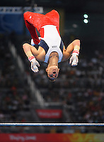 Aug. 9, 2008; Beijing, CHINA; Alexander Artemev (USA) performs on the horizontal bar during mens gymnastics qualification during the Olympics at the National Indoor Stadium. Mandatory Credit: Mark J. Rebilas-