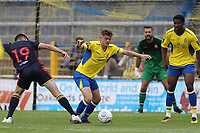 Taylor Miles of St Albans wins a tackle against Danny Newton of Stevenage during St Albans City vs Stevenage, Friendly Match Football at Clarence Park on 13th July 2019