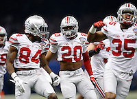 Ohio State's Corey Smith (84), Ron Tanner (20), and Chris Worley (35) celebrate a special teams tackle during the first quarter of the Allstate Sugar Bowl college football playoff semifinal against the Alabama Crimson Tide at the Mercedes-Benz Superdome in New Orleans on Jan. 1, 2015. (Adam Cairns / The Columbus Dispatch)