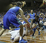SIOUX FALLS, SD - NOVEMBER 30:  Connor Devine #30 from South Dakota State University controls the ball while falling to the ground between Zach Johnson #12 and  Demetris Morant #21 from Florida Gulf Coast in the second half of their game Sunday afternoon at the Sanford Pentagon in Sioux Falls. (Photo by Dave Eggen/inertia)