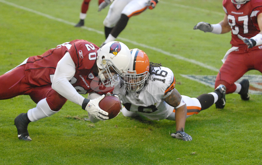 Dec. 2, 2007; Glendale, AZ, USA; Arizona Cardinals cornerback Ralph Brown (20) recovers a fumbled punt by Cleveland Browns wide receiver Josh Cribbs (16) at University of Phoenix Stadium. Arizona defeated Cleveland 27-21. Mandatory Credit: Mark J. Rebilas-US PRESSWIRE