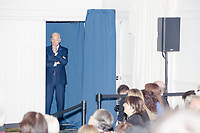 Democratic presidential candidate and former Vice President Joe Biden waits to enter to speak at a campaign event at the Governor's Inn and Restaurant in Rochester, New Hampshire, on Wed., October 9, 2019. At this event, Biden said for the first time that he supported the impeachment inquiry against current President Donald Trump.