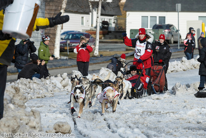 Aliy Zirkle runs past spectators on Cordova street during the cermonial start day of Iditarod 2015 in Anchorage, Alaska. Saturday March 7, 2015<br /> <br /> (C) Jeff Schultz/SchultzPhoto.com - ALL RIGHTS RESERVED<br />  DUPLICATION  PROHIBITED  WITHOUT  PERMISSION