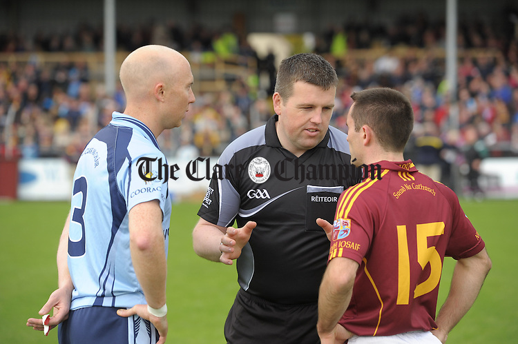 Captains Conor Marrinan of Cooraclare and Brian Curtin of Miltown with referee John Hannan before the county senior football final at Cusack park. Photograph by John Kelly.