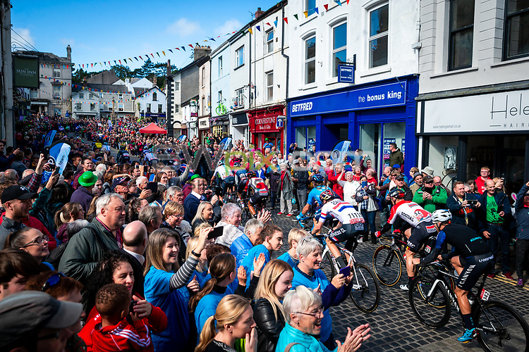 Picture by Alex Whitehead/SWpix.com - 07/09/2018 - Cycling - OVO Energy Tour of Britain - Stage 6: Barrow-in-Furness to Whinlatter - The peloton in action through Ulverston. - crowds, fans, spectators