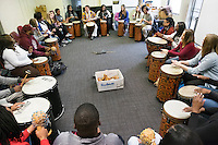 Students in Professor of Music Robert Damm's African American music class form a drum circle as part of a lesson on the international roots of African American music. Damm led the students through traditional West African compositions.<br />