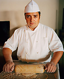 TURKEY, Istanbul, portrait of a baker preparing bread at Ulus 29 Restaurant.