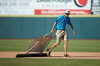 A member of the Hickory Crawdads grounds crew drags the infield between innings of the game against the Greensboro Grasshoppers at L.P. Frans Stadium on May 26, 2019 in Hickory, North Carolina. The Crawdads defeated the Grasshoppers 10-8. (Brian Westerholt/Four Seam Images)