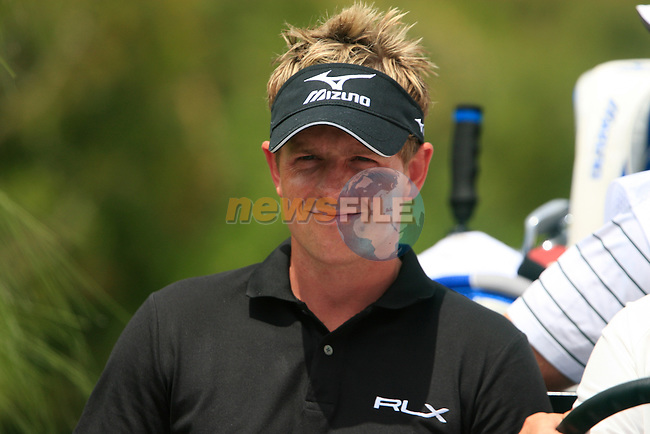 Luke Donald (ENG) gets a lift to the 5th tee during the afternoon session on Day 2 of the Volvo World Match Play Championship in Finca Cortesin, Casares, Spain, 20th May 2011. (Photo Eoin Clarke/Golffile 2011)
