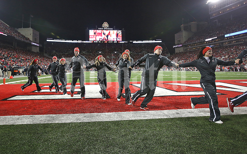 The OSU cheerleaders celebrate a third quarter td against Illinoisi at Ohio Stadium on November 1, 2014. (Chris Russell/Dispatch Photo)