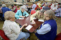 NWA Democrat-Gazette/DAVID GOTTSCHALK Helen Roderick (from left), Rozella Scott, Mary Ann Frederick and Pat Ackerman play Bunco Tuesday, April 10, 2018, with others at the Springdale Senior Activity and Wellness Center. Frederick was ringing the bell signifying that a player at her table had reached 21. The center will undergo a needs assessment to direct the future of the center.