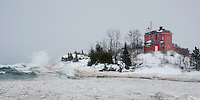 The beautiful red Marquette lighthouse during a strong U.P. winter storm. Marquette, MI