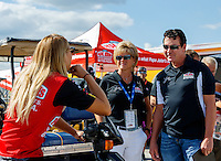 Sep 2, 2016; Clermont, IN, USA; Papa Johns pizza founder John Schnatter (right) and wife Annette Schnatter (center) talk with top fuel driver Leah Pritchett during NHRA qualifying for the US Nationals at Lucas Oil Raceway. Mandatory Credit: Mark J. Rebilas-USA TODAY Sports