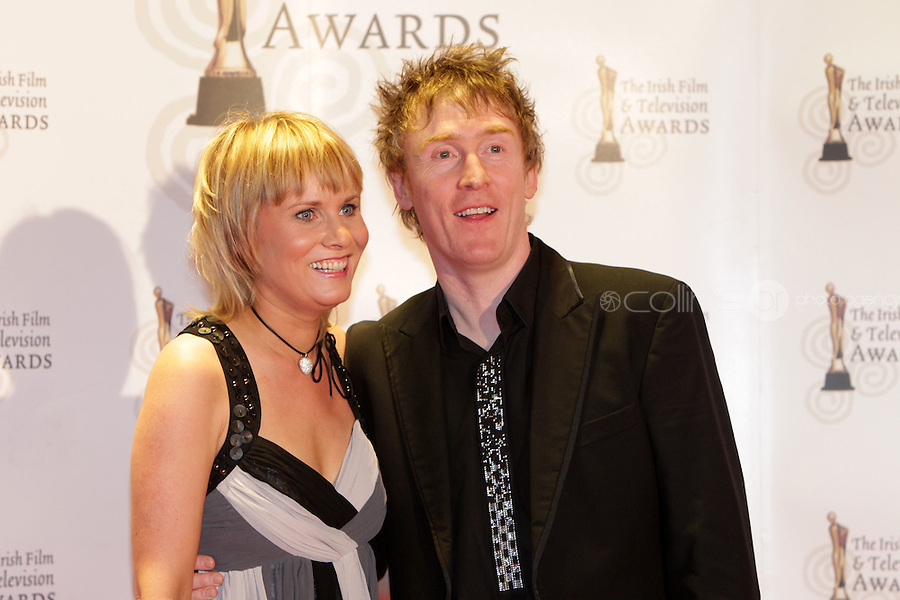 12/2/11 Hector O Heochagain and wife Dympna on the red carpet at the 8th Irish Film and Television Awards at the Convention centre in Dublin. Picture:Arthur Carron/Collins