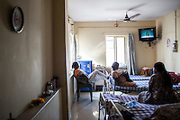 Surrogates pass their time doing embroidery and watching television in the surrogates hostel on the 3rd floor of Dr. Nayana Patel's Akanksha IVF and surrogacy center in Anand, Gujarat, India on 11th December 2012. Photo by Suzanne Lee / Marie-Claire France