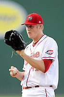 Starting pitcher Ty Buttrey (47) of the Greenville Drive delivers a pitch in a game against the Charleston RiverDogs on Thursday, August 21, 2014, at Fluor Field at the West End in Greenville, South Carolina. Charleston won, 12-0. (Tom Priddy/Four Seam Images)