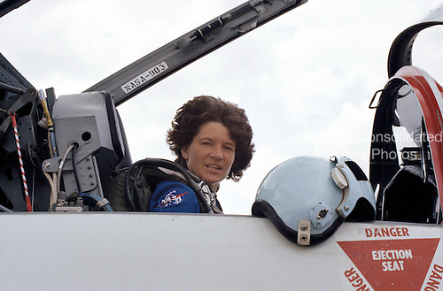 Astronaut Sally K. Ride, STS-7 mission specialist, takes one last look at familiar training environs before taking off from NASA's Houston facility in a T-38 jet aircraft, destination: Florida and the Kennedy Space Center (KSC) on June 15, 1983. After a few days of preparation at KSC, Dr. Ride and four other astronauts will be the first NASA five-member crew to fly in space as they liftoff in the Challenger from Launch Pad 39A. The mission specialist is positioned in the rear station of the jet, piloted by astronaut Robert L. Crippen, STS-7 commander. The T-38 fleet is kept at Ellington Base near the Johnson Space Center (JSC).  Dr. Ride passed away due to Pancreatic Cancer on Monday, July 23, 2012..Credit: NASA via CNP