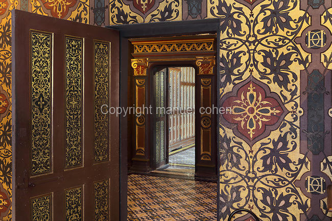 Painted decorative doorway leading through the Oratory, a small private chapel, to the Chambre de la Reine or Queen's Bedroom, decorated in 16th century Renaissance style and restored by Felix Duban in 1861-66, on the first floor of the Francois I wing, built early 16th century in Italian Renaissance style, at the Chateau Royal de Blois, built 13th - 17th century in Blois in the Loire Valley, Loir-et-Cher, Centre, France. The chateau has 564 rooms and 75 staircases and is listed as a historic monument and UNESCO World Heritage Site. Picture by Manuel Cohen