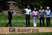 (L-R) French President Francois Hollande, U.S. President Barack Obama, German Chancellor Angela Merkel and Italian Prime Minister Mario Monti pose for a group photo during the 2012 G8 Summit at Camp David May 19, 2012 in Camp David, Maryland. Leaders of eight of the worlds largest economies meet over the weekend in an effort to keep the lingering European debt crisis from spinning out of control.  .Credit: Luke Sharrett / The New York Times / Pool via CNP