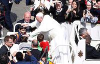 Papa Francesco saluta alcuni bambini al termine della messa della Domenica delle Palme in Piazza San Pietro, 20 marzo 2016.<br /> Pope Francis greets some children after celebrating the Palm Sunday mass in St. Peter's Square at the Vatican, 20 March 2016.<br /> UPDATE IMAGES PRESS/Riccardo De Luca<br /> <br /> STRICTLY ONLY FOR EDITORIAL USE