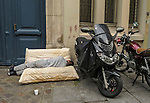 VMI Vincentian Heritage Tour: Sleeping on a mattress in the African community along the Rue du Faubourg near the Porte Saint-Denis, Thursday, June 23, 2016, as they toured Vincentian sites in Paris. (DePaul University/Jamie Moncrief)