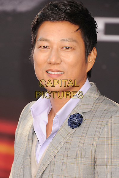 "Sung Kang.arriving at the Los Angeles Premiere of ""Fast & The Furious 6"" at Gibson Amphitheatre in Universal City, California, USA, .May 21st, 2013. .portrait headshot grey gray suit plaid checked check .CAP/ROT/TM.©Tony Michaels/Roth Stock/Capital Pictures"