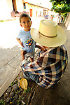 A boy and his grandfather in the \ hilltop town of Suchitoto, El Salvador.