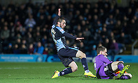 Callum Preston of Crawley Town gathers under pressure from Michael Harriman of Wycombe Wanderers during the Sky Bet League 2 match between Wycombe Wanderers and Crawley Town at Adams Park, High Wycombe, England on 28 December 2015. Photo by Andy Rowland / PRiME Media Images