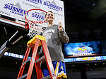 SIOUX FALLS, SD - MARCH 8:  Macy Miller from South Dakota State University cuts the net following their 61-55 win over the University of South Dakota in the 2016 Summit League Championship Game Tuesday afternoon in Sioux Falls. (Photo by Dave Eggen/Inertia)