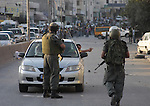 Israeli border policemen stand guards during clashes with Palestinian stone-throwers at the Kalandia checkpoint between the West Bank city of Ramallah and Jerusalem, Thursday, Oct. 8, 2009. President Barack Obama's Mideast envoy finds himself increasingly hamstrung, with Israel's foreign minister on Thursday all but ruling out a peace deal for years to come and the Palestinian leader weakened by his decision not to push for a Gaza war crimes tribunal against Israel.  Photo by Mohamar Awad