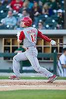 Preston Palmeiro (12) of the North Carolina State Wolfpack follows through on his swing against the Charlotte 49ers at BB&T Ballpark on March 31, 2015 in Charlotte, North Carolina.  The Wolfpack defeated the 49ers 10-6.  (Brian Westerholt/Four Seam Images)