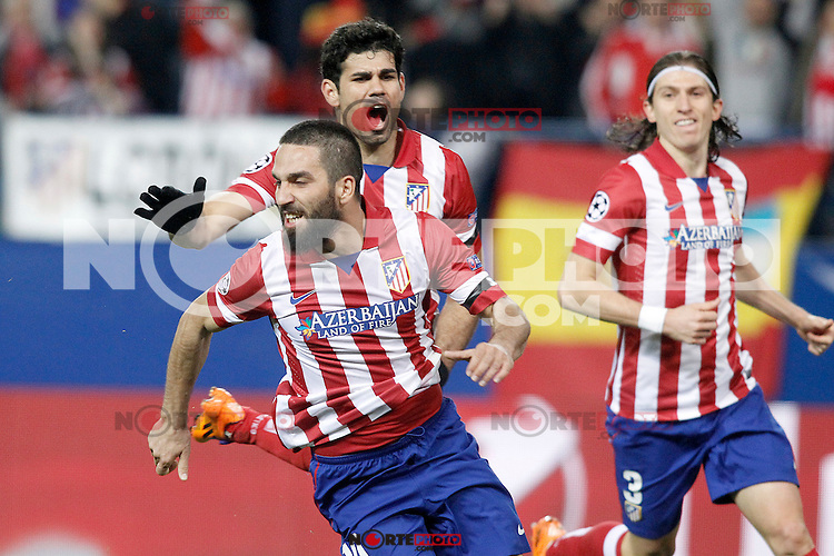Atletico de Madrid's Arda Turan, Diego Costa and Filipe Luis celebrate goal during Champions League 2013/2014 match.March 11,2014. (ALTERPHOTOS/Acero)