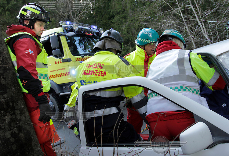 Instructors from Norwegian Air Ambulance train local rescue workers how to rapidly extract car crash victims.