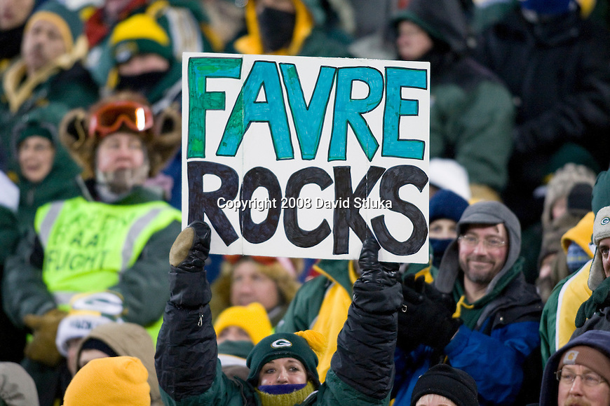 A fan displays a homemade sign during the Green Bay Packers game against the New York Giants during the NFC Championship game at Lambeau Field on January 20, 2008 in Green Bay, Wisconsin. The Giants defeated the Packers 23-20 in overtime to advance to Superbowl XLII. (AP Photo/David Stluka)
