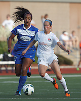 Sky Blue FC midfielder Manya Makoski (22) controls the ball as Boston Breakers midfielder Mariah Noguiera (20) pressures. In a National Women's Soccer League (NWSL) match, Boston Breakers (blue) defeated Sky Blue FC (white), 3-2, at Dilboy Stadium on June 30, 2013.