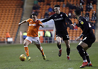 Blackpool's John O'Sullivan under pressure from Barnsley's Kieffer Moore<br /> <br /> Photographer Rich Linley/CameraSport<br /> <br /> The EFL Sky Bet League One - Blackpool v Barnsley - Saturday 22nd December 2018 - Bloomfield Road - Blackpool<br /> <br /> World Copyright &copy; 2018 CameraSport. All rights reserved. 43 Linden Ave. Countesthorpe. Leicester. England. LE8 5PG - Tel: +44 (0) 116 277 4147 - admin@camerasport.com - www.camerasport.com