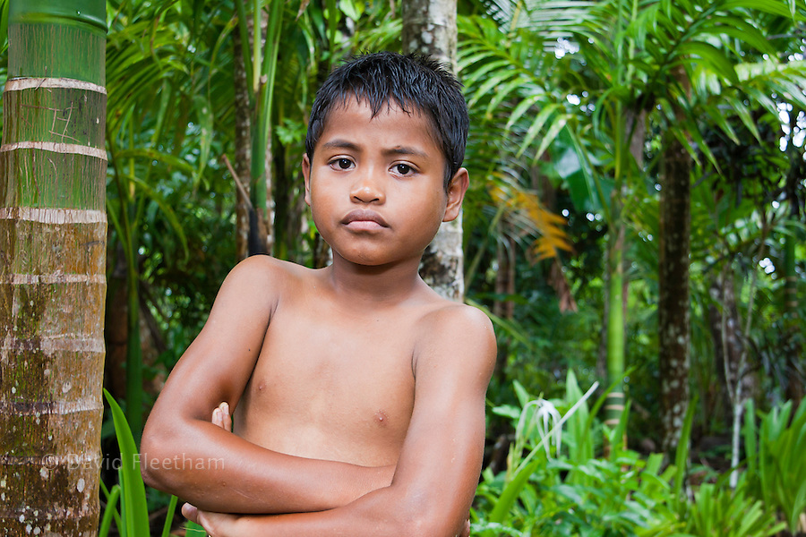 This young native boy is standing in the center of his village, Kadai, on the island of Yap, Micronesia.