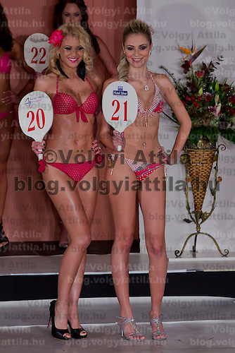 Marianna Bertok (L) winner of the contest and Greta Varga (R) participant from Dunaszerdahely attend the Miss Hungary beauty contest held in Budapest, Hungary on December 29, 2011. ATTILA VOLGYI