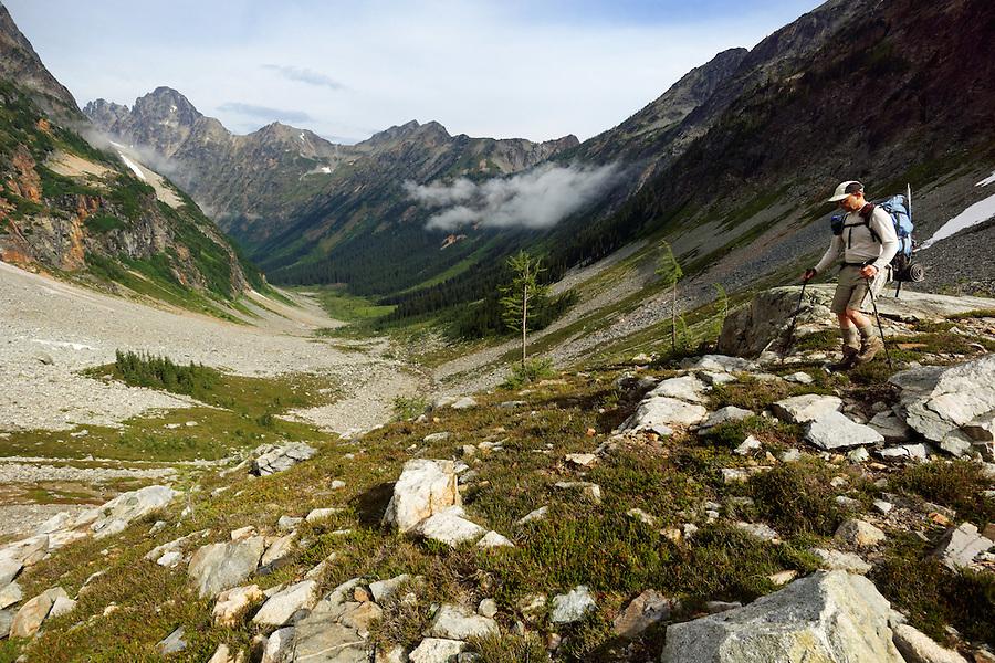 Man backpacking in Fisher Creek Basin, North Cascades National Park, Skagit County, Washington, USA