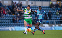 Myles Weston of Wycombe Wanderers & Ryan Dickson of Yeovil Town during the Sky Bet League 2 match between Wycombe Wanderers and Yeovil Town at Adams Park, High Wycombe, England on 14 January 2017. Photo by Andy Rowland / PRiME Media Images.